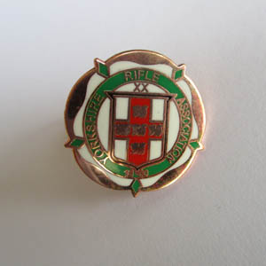 This image has an empty alt attribute; its file name is enamel_badge.jpg